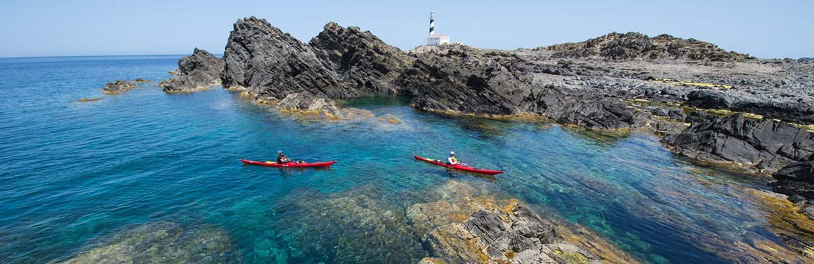 Sea Kayaking with kayaking.ie around the Balearic Island of Menorca near the Favàritx Lighthouse.